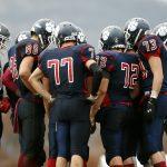 Football team in a huddle